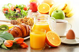 Fototapety Breakfast with coffee, juice, croissant, salad, muesli and egg