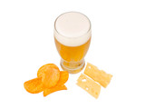 Glass of beer with crisps and cheese over white background