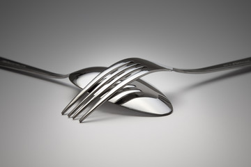 Reflection of a fork on the spoon