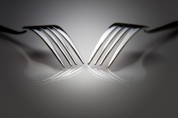 Reflection of the two forks on the table