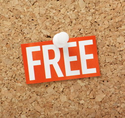 The word Free pinned to a cork notice board
