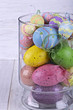 Colorful Easter eggs in a glass vase
