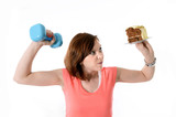 Sport Woman lifting weight and cake