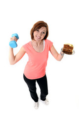 Young Attractive Red Hair Sport Woman lifting weight and cake