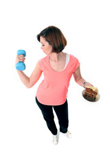 Young Red Hair Sport Woman lifting weight and cake