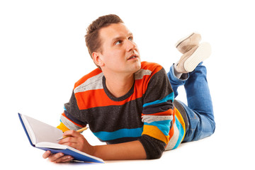 Man college student lying and reading book studying for exam