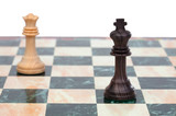 The king and queen faced. Wooden chess pieces