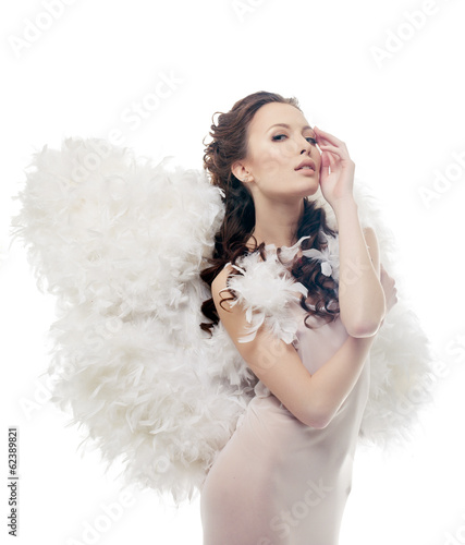 Charming sensual girl posing as angel, close-up