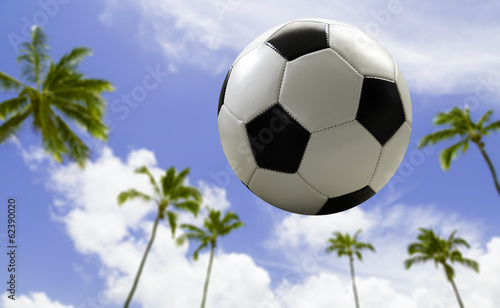 Soccer ball traveling on the beach