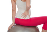 Pregnant woman on pilates ball with back pain