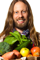 Hippie man holding bag of fresh fruit and vegetables