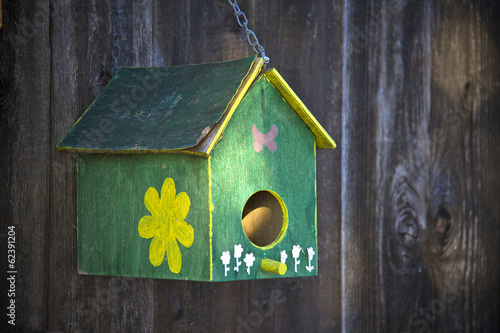 Bird house on the fence