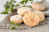 Flat bread of wheat flour with fresh herbs