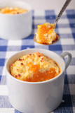 Spoon of cottage cheese casserol with pumpkin