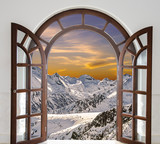 Arch door opened with views of the peaks of snowy mountains and