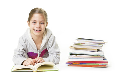 School Girl smiling while reading books