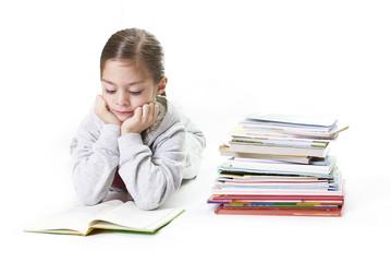 Elementary Age Girl Reading Books. Isolated on white