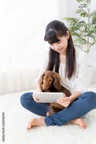 young asian woman and dog lifestyle image
