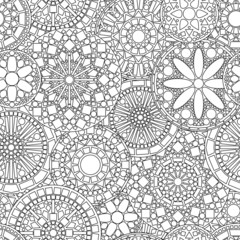 Lacy circle flower mandalas seamless pattern in black and white
