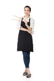 Young Asian housewife hold a chopsticks