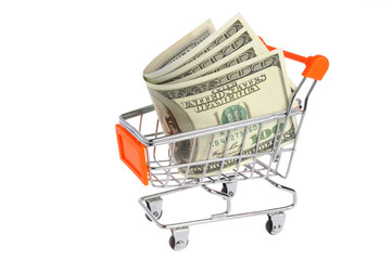 Money in shopping cart isolated on white background