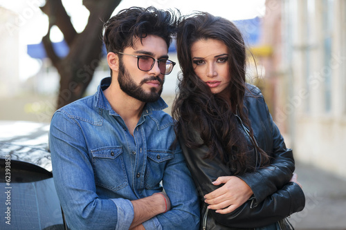 young casual couple with hands crossed