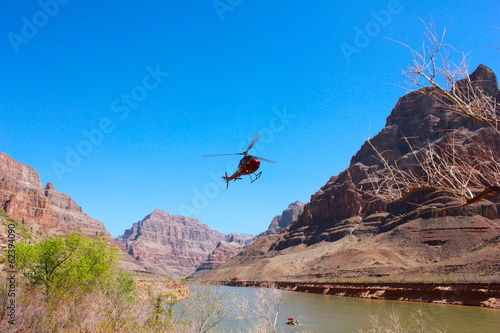 Tuinposter Canyon Helicopter flying over Grand Canyon National Park