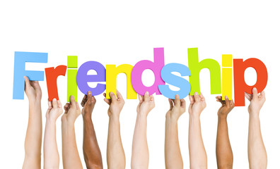 Multiethnic Group of People Holding Word Friendship