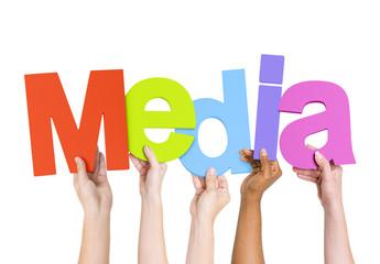 Multi Ethnic People Holding The Word Media