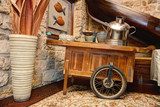 Decorative Vintage Wooden cart with metal pot and a vase