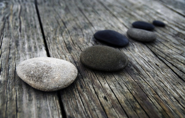 Smooth Pebbles on Old Wooden Pier