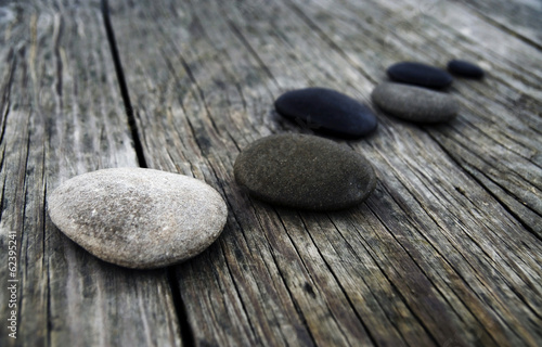 canvas print picture Smooth Pebbles on Old Wooden Pier