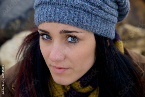 Young woman closeup feeling sad with hat