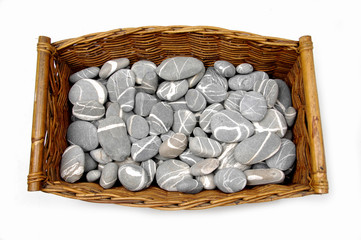 Basket of river stones isolated