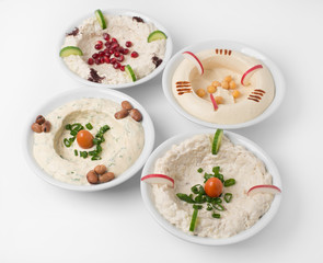 Arabic traditional Hummus Plates with different toppings
