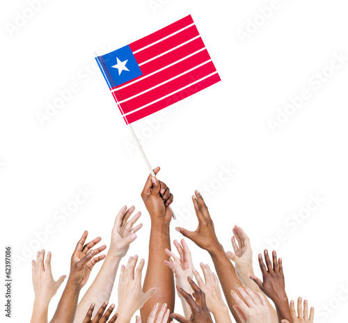 Group Diverse Hands Holding The Flag of Liberia