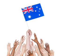 Diverse Human Hands Holding Australian Flag