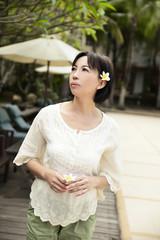 Asian woman enjoying spring flowers in the garden
