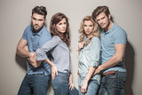 fashion models in blue jeans and casual polo shirts