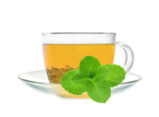 Transparent cup of green tea and mint herb isolated on white