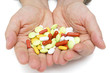 Hand with colorful pills, over dosing with medicals
