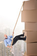 Businessman climbing boxes
