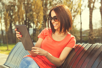 Brunette using digital tablet