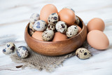 Raw quail and chicken eggs, horizontal shot