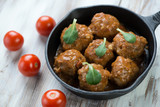 Meatballs with tomato sauce, horizontal shot