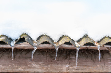 row of icicles from the roof