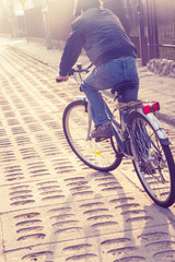teenager riding bike on street