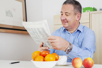 Man reading the newspaper in his spare time