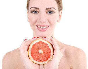 Beautiful young woman holding grapefruit, isolated on white