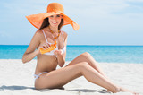 Woman At Beach With Moisturizer